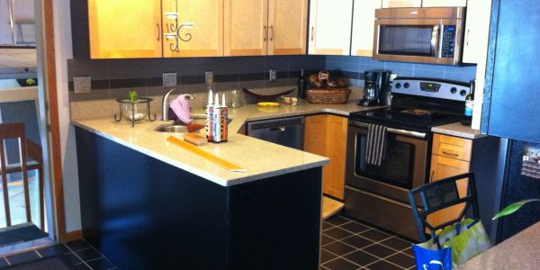Painted black cabinets and maple doors kitchen remodel