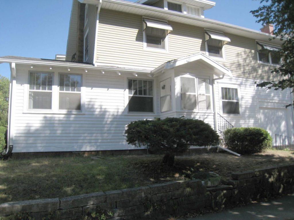 SE Cedar Rapids Painted residential exterior white lower green upper