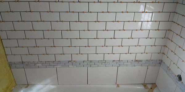 tile spaced shower surround white subway tile with marble border