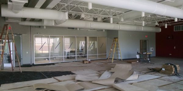Commercial painting project at a sports complex during renovation, exposed painted ducting