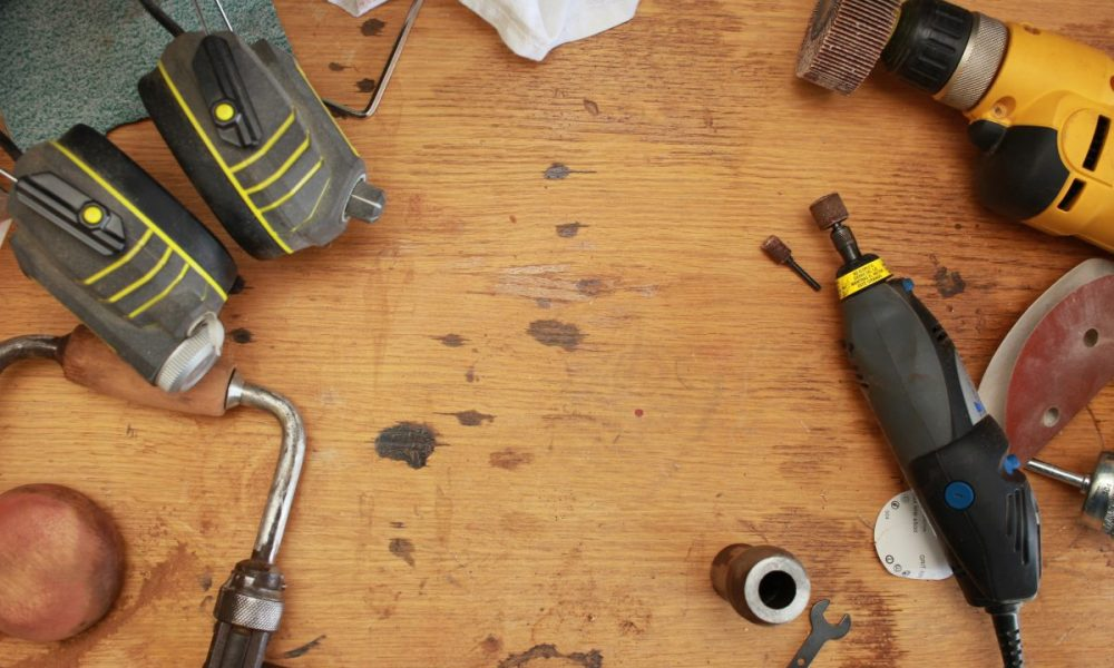 handyman tools lying around on wood floor