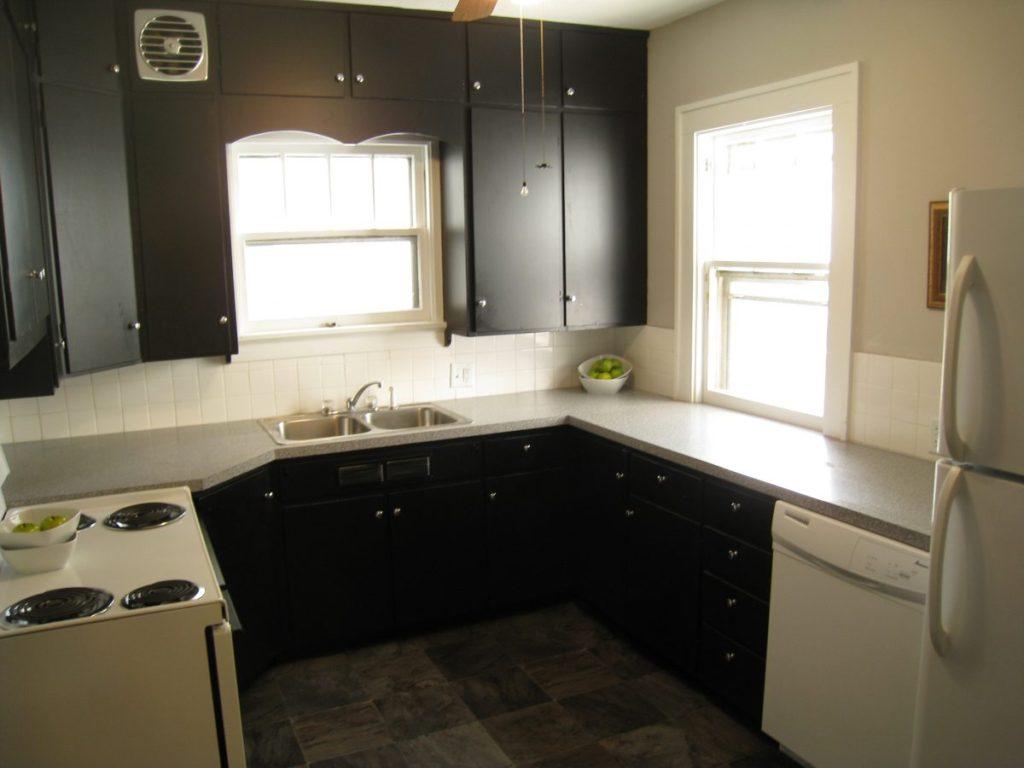 Kitchen remodel, black painted cabinets, gray counters, white tile backsplash