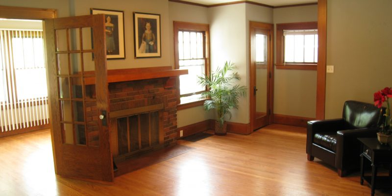 Historical home living room renovation. Oak hardwood, original trim and fireplace