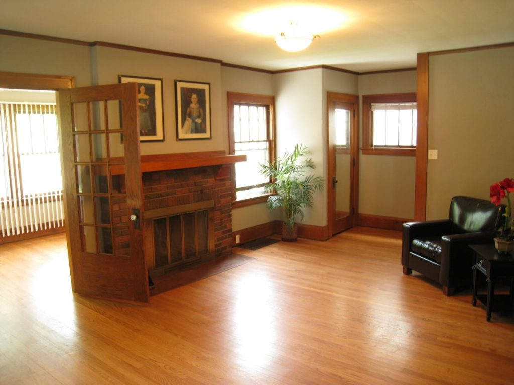 Historical home living room renovation. Oak hardwood, original trim and fireplace