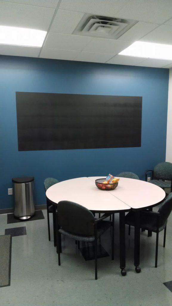 MRICR breakroom with black chalkboard wall painted on blue wall
