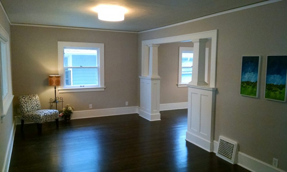 home remodeling project with gray walls, white built ins and trim, and ebony stained hardwood floors