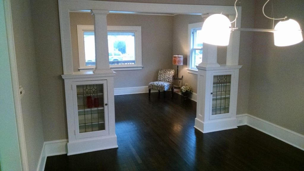 Interior renovation with gray walls, white built ins and trim, and ebony stained hardwood floors