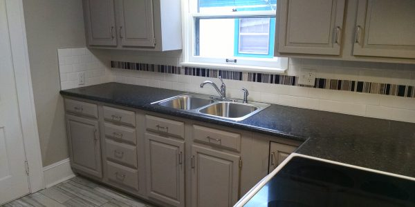 monotone kitchen renovation with custom subway tile and stone backsplash