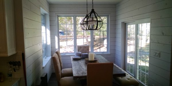 Rustic modern sunroom with ship lap walls staged