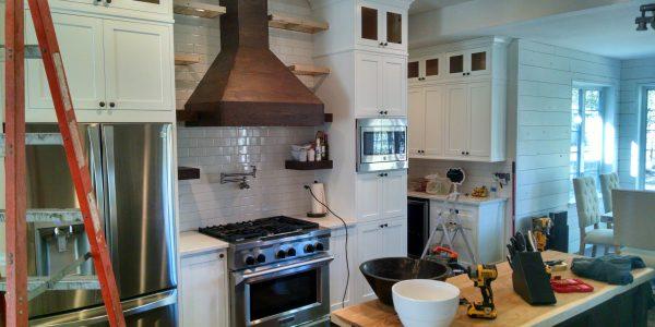 Rustic modern kitchen renovation, white cabinets under construction