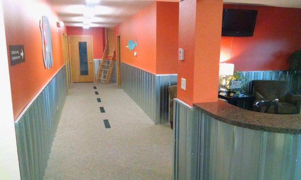 River of Life Children's Wing Hallway Renovation Orange Walls and Corrugated Steel panels