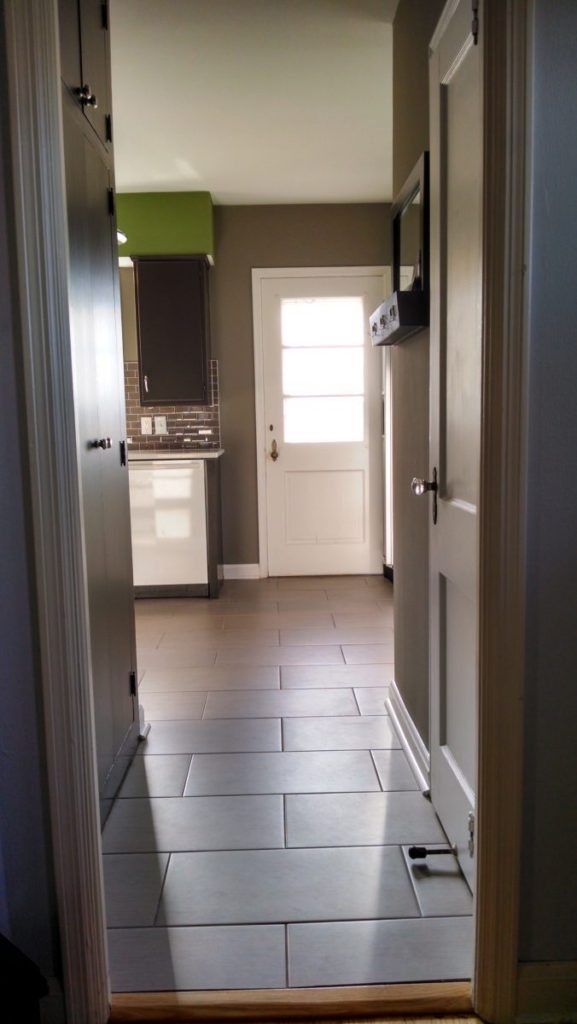 kitchen entryway remodel with subway tile floor and subway tile backsplash