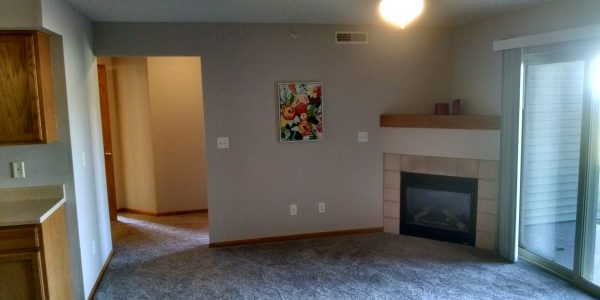North Liberty home remodeling pic of updated condo gray walls oak trim beige carpet